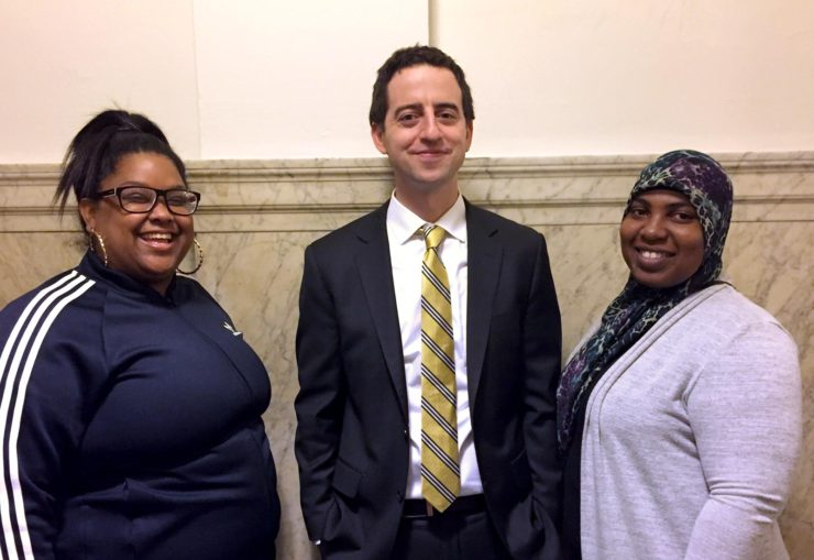 Staff attorney Dan Urevick-Ackelsberg and his clients Yazmin Vazquez (left) and Gerrell Martin (right). Yazmin and Gerrell are tenants fighting for their rights.